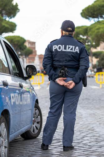 Fototapeta Italian policewoman on patrol in the city