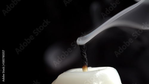 Photo Photo of smouldering wick and smoky cloud on black background