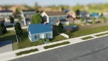 Small Suburban House In A Nice Neighborhood. Tilt Shift Effect. Digital 3D Render.