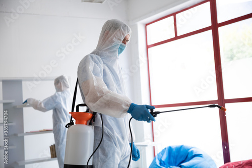 Health worker wearing protective clothes cleaning using disinfectant
