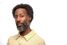 Portrait Of Middle Aged Black Man With Greying Beard, Looking At Camera With Straight Face