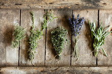 Bundled Herbs On Wooden Surface