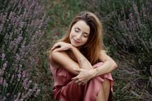 Woman Sitting In Lavender Field