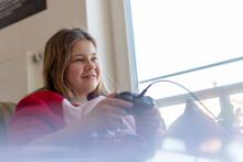Smiling Girl Playing Video Gam...