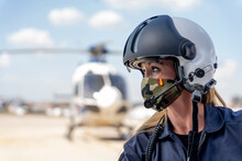 Female Police Pilot Looking Away While Wearing Protective Face Mask