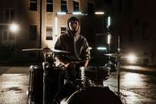 Young Male Drummer Sitting Wit...