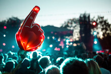 Large Foam Hand Over Crowd Of ...