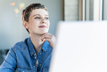 Businesswoman Thinking At Desk In Office