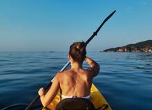 Woman Kayaking While Sitting I...