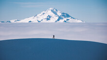 Man Hiking On Dome Peak With G...