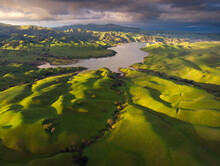 Scenic View Of Lake Surrounded By Hills