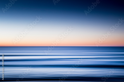Fototapeta Blurred motion of sea at dawn