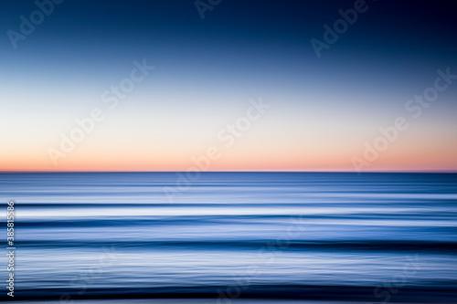 Blurred motion of sea at dawn Wallpaper Mural