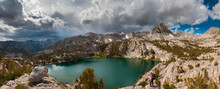 Man Looking At Storm Clouds Over Lower Lamarck Lake In John Muir Wilderness