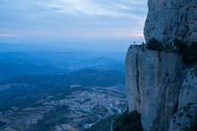 Hiker Standing On Top Of Mount...