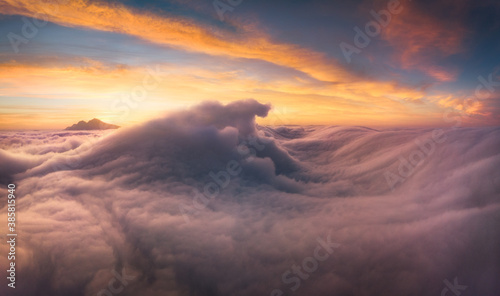 Scenic view of landscape covered with fog during sunrise