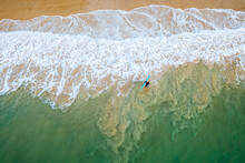 Aerial View Of Man With Surfbo...