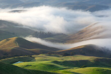 Scenic View Of Fog Over Hills