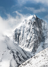 Scenic View Of Mountain Peak Against Cloudy Sky