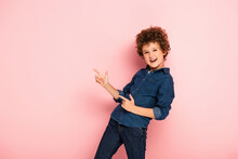 Excited Curly Boy In Denim Shi...