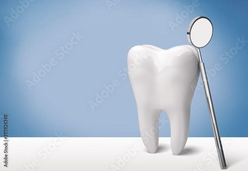 Obraz Big tooth and dentist mirror on desk - fototapety do salonu