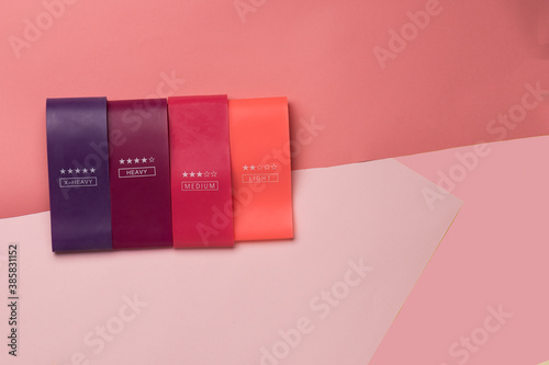 Stampa su Tela Multicolored Exercise Rubber Band Fitness on pink background