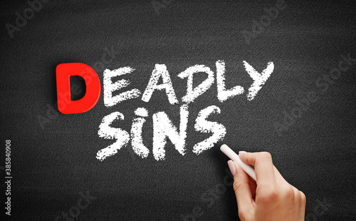 Foto Deadly sins text on blackboard, concept background