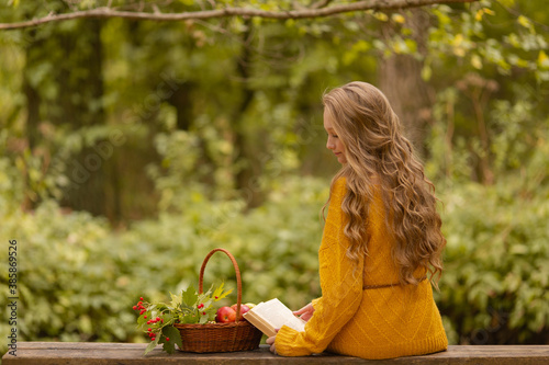 Cute teen girl falls in the woods with apple and ash Wallpaper Mural