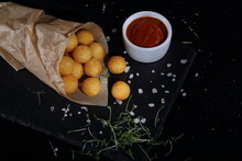 Potato Balls With Cheese Filling In Paper Bag