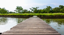 Old Brown Wooden Bridge With T...