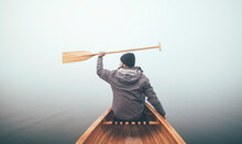Active Man Holds Canoe Paddles...