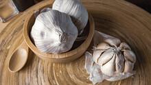 Garlic In Wood Bowl  On Wood T...