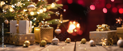 Fototapeta Christmas Tree With Gifts Near A Fireplace With Lights obraz