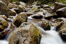 Water Flowing In Rocks In Wild...