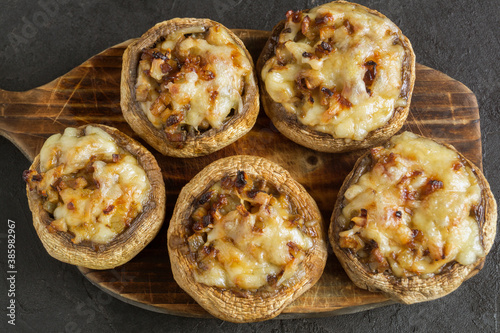 Fotografie, Tablou mushrooms baked with cheese and onions.