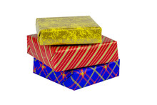 Three Multi-colored Boxes With Gifts On A White Background.