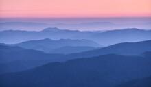 Mountain Ridges In Fog At Suns...