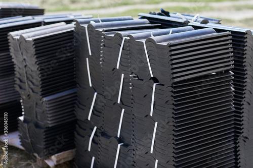 Fotografie, Obraz Stacks of dark modern roof tiles for covering the house