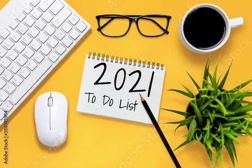 2021 Happy New Year Resolution Goal List - Business office desk with notebook written in handwriting about plan listing of new year goals and resolutions setting Wallpaper Mural