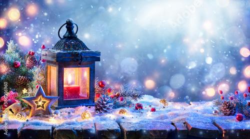 Fotografia, Obraz Christmas Lantern With Fir Branch and Decoration On Snowy Table