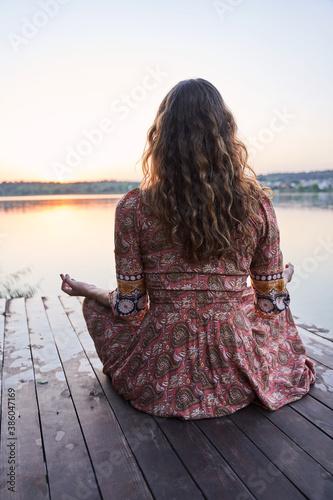 Girl meditates while practicing yoga Fototapeta