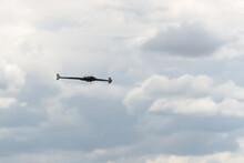 Delta Remote Control Flying Wing, Front On With A Cloudy Background.