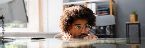 Obraz African American Sneaky Man Avoiding Work - fototapety do salonu