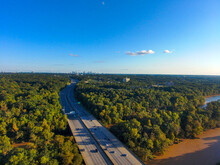 A Stunning Aerial Shot Of Vast Miles Of Lush Green Trees, The Freeway, The Chattahoochee River And Blue Sky At Sunset  At The Chattahoochee River National Recreation Area In Sandy Springs Georgia