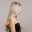 Leinwandbild Motiv wavy blonde hair side view in profile. Copycpase