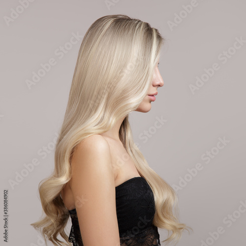 Leinwand Poster wavy blonde hair side view in profile. Copycpase