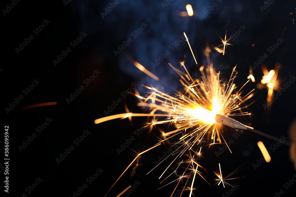 Fototapeta The burning sparklers diwali festival. Celebrating Diwali in india.