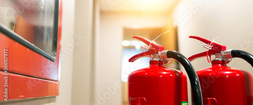 Tela Red fire extinguisher tank at the exit door in the building concepts of emergency safety for fire prevention rescue and fire services concetps
