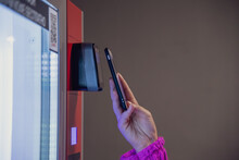 Close Up View Of Woman Paying For Purchase At Snack Vending Machine Using Smartphone. Contactless Payment Theme.
