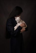 Classic Lovely Studio Portrait Of Girl Holding White Cat  In Painterly Dark Rembrandt Style